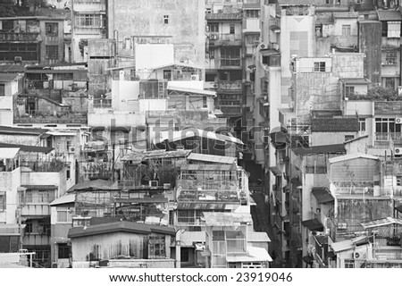 Old buildings in Macau (China's Special Administrative Region) with different types of roof extensions built by the residents. - stock photo
