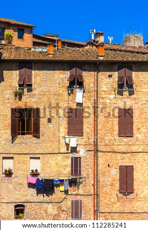 Old buildings in Siena, Italy - stock photo