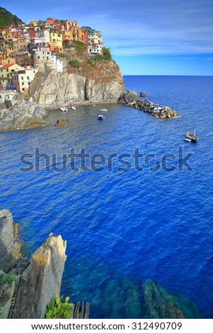Old buildings of Manarola above the sea at dusk, Cinque Terre, Italy