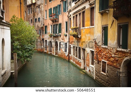 Old buildings on canal in Venice - stock photo