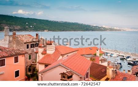 Old buildings roofs over harbor at Opatija shore, popular touristic destination, Adriatic coast, Croatia. - stock photo