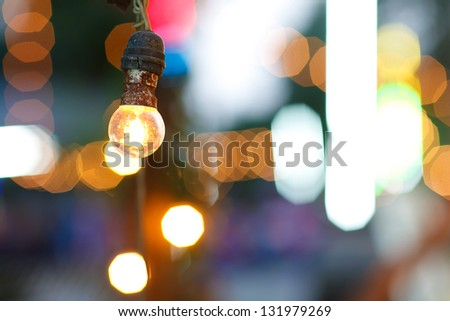 Old bulb with bokehs in festival - stock photo