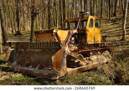 Old bulldozer in a forest - stock photo