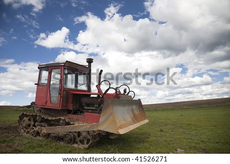 old bulldozer    on the grass field with the blue sky background  in china.