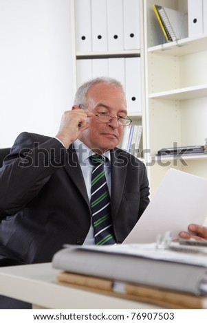 Old Business man in office - stock photo