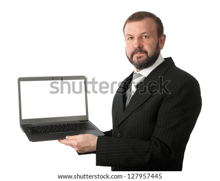 old business man with a laptop computer isolated on white background - stock photo