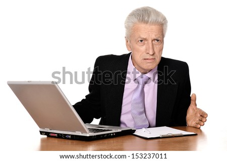 Old businessman working with notebook isolated on white background - stock photo