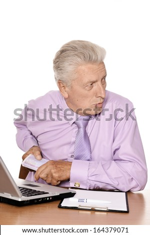 Old businessman working with notebook isolated on white background