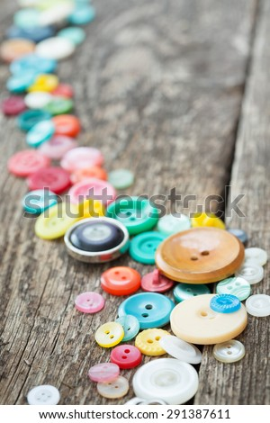old buttons on wooden boards - stock photo