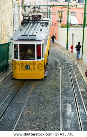 Old cable car in Lisbon, Portugal - stock photo