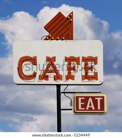 """Old cafe sign with the word """"eat"""" against a cloudy sky. - stock photo"""