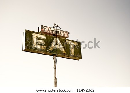 "Old cafe sign with the word ""eat"" by pearsonville california.usa"