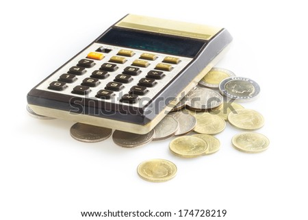 Old calculator and coins, isolated on white - stock photo