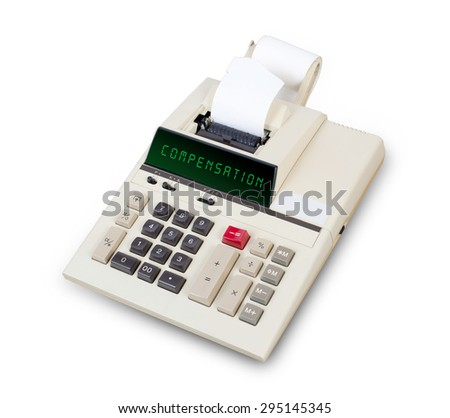 Old calculator showing a text on display - compensation - stock photo
