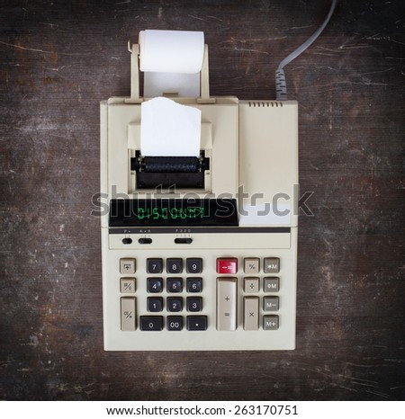 Old calculator showing a text on display - discount - stock photo