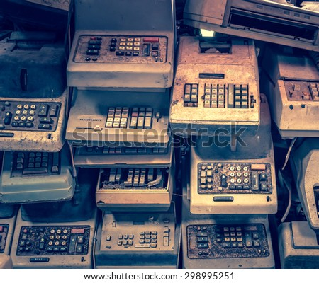 old calculators - vintage grunge collection antique keypad button technology finance - stock photo