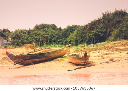 Old cambodian wooden boats river bank stock photo royalty free old cambodian wooden boats in the river bank publicscrutiny Image collections