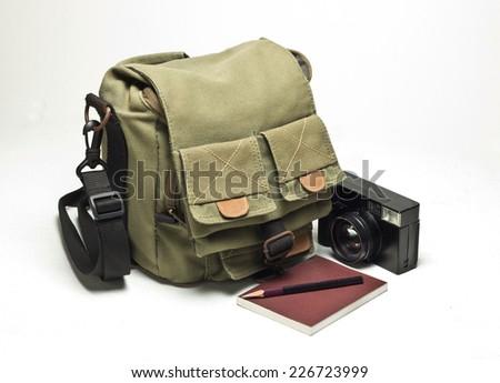 Old camera and bag,  vintage photo grunge lighting version design component - stock photo