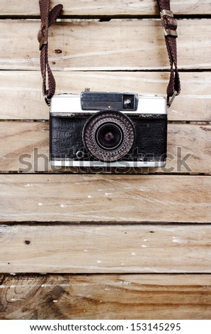 Old camera and on wooden table, Space for text or image for design work - stock photo