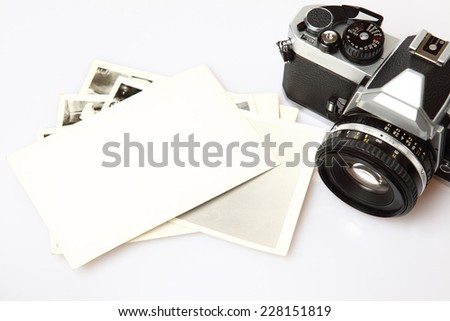 Old Camera & Blank Photo paper on the white background. - stock photo