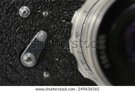 old camera detail shallow focus on aperture - stock photo