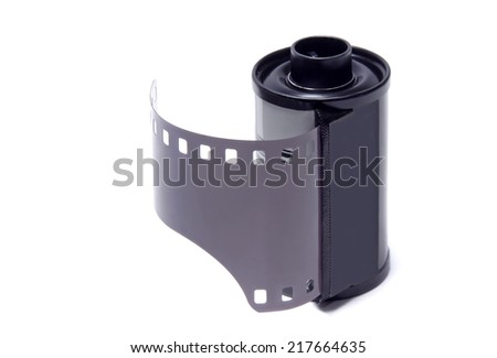 Old camera film over a white background.Studio shot.  - stock photo