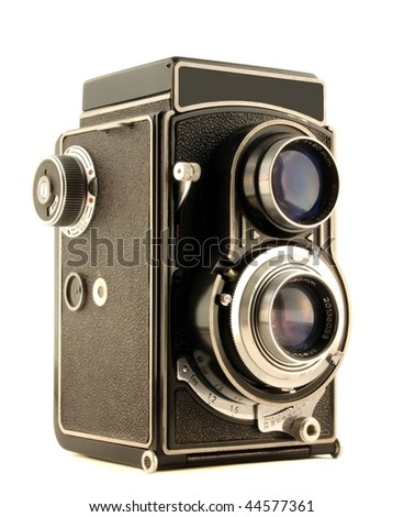 Old camera isolated on pure white - stock photo