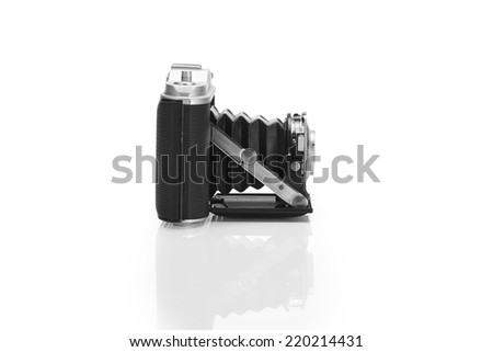Old camera isolated on pure white background with clipped path - stock photo