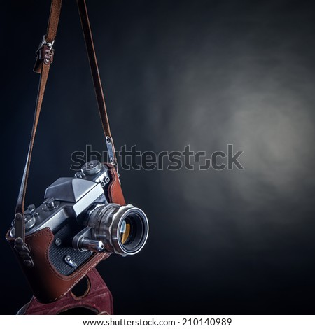 old camera on a black background - stock photo