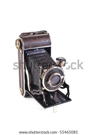 Old camera on a plain white background. - stock photo