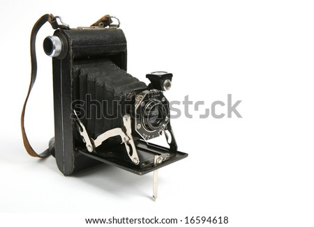 Old camera on white background. - stock photo
