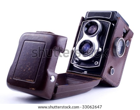 old camera on white background - stock photo