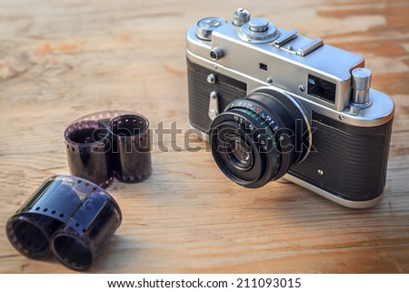 Old camera on wooden background - stock photo