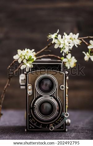 old camera retouching Vintage - stock photo