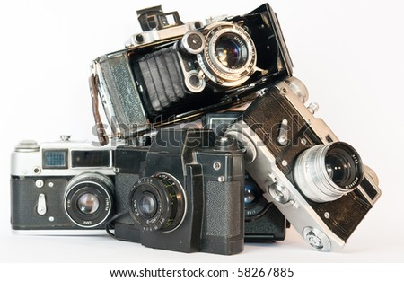 OLD CAMERAS PYRAMID ON A WHITE - stock photo