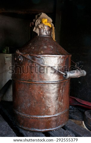Old can with lubricant - stock photo