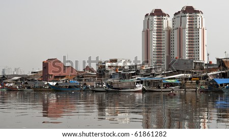 Old canal full of boats in Jakarta harbor, Indonesia - stock photo