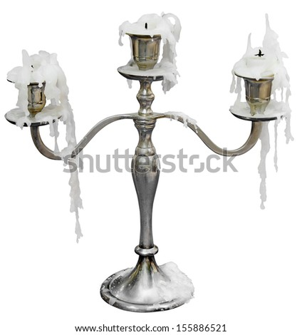 Old Candlestick with three candles isolated on white background  - stock photo