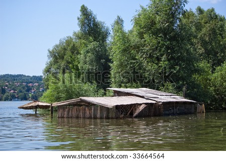Old cane cottage flooded to the roof - stock photo