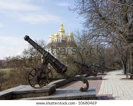 Old cannones in Chernigov. On background sky and cossack's church. - stock photo