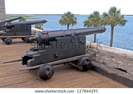 Old canons aiming at the sea, in a fort, on an overcast day. Castillo de San Marcos, St. Augustine, Florida. 16th century. - stock photo