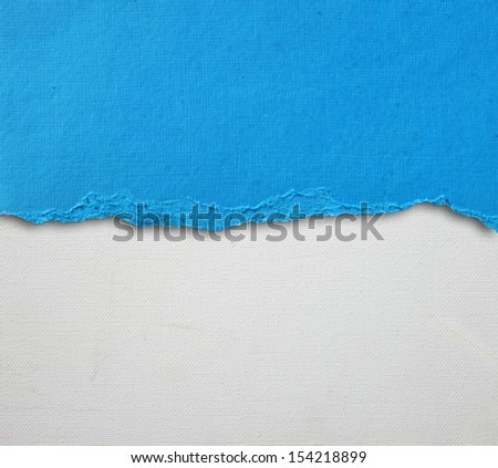 old canvas texture background with delicate stripes pattern and blue vintage torn paper  - stock photo