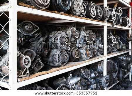 Old car alternators on shelf.