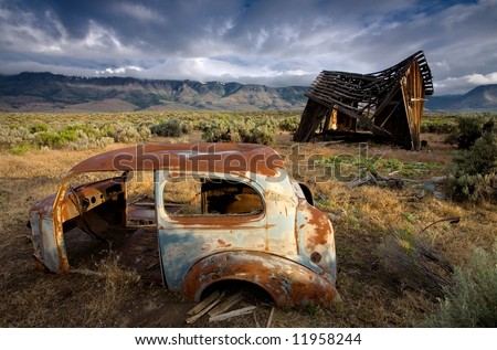 Old Car and Barn - stock photo