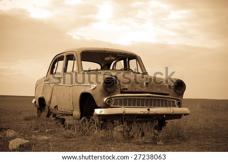 Old car at field - stock photo