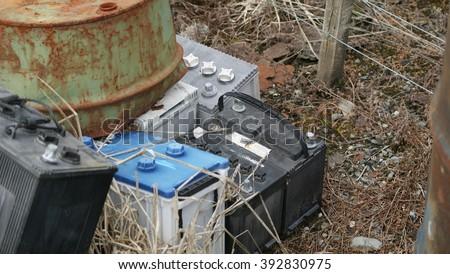 Old car batteries thrown away - stock photo