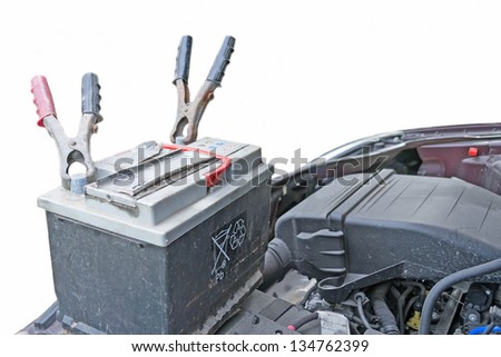 old car battery and jumper pincers - stock photo