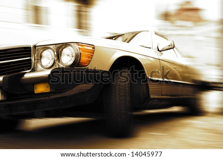 Old car driving fast - stock photo