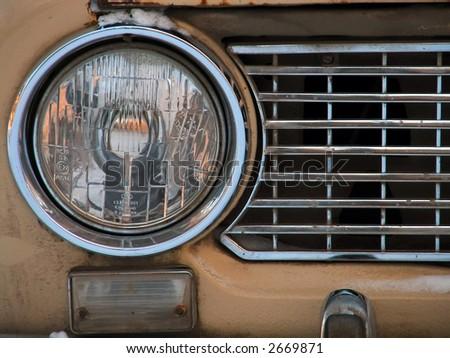 Old car headlight - stock photo