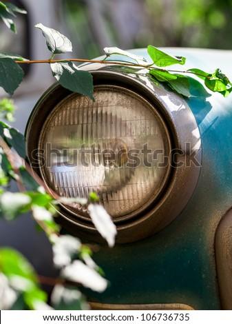 old car headlights - stock photo